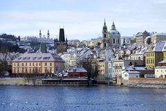 Snowy freeze Prague Lesser Town with St. Nicholas` above River Vltava, Czech republic Royalty Free Stock Photo