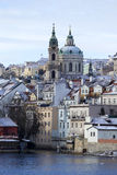 Snowy freeze Prague Lesser Town with St. Nicholas` above River Vltava, Czech republic Royalty Free Stock Images