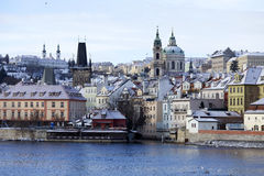 Snowy freeze Prague Lesser Town with St. Nicholas` Cathedral, Czech republic Royalty Free Stock Image