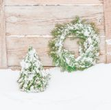 Snowy frosted Christmas wreath. Wreath of fir branches. Stock Photo