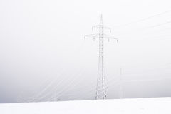 Snowy and frozen power lines Royalty Free Stock Images