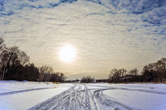 Snowy Frozen River. The Grand River, frozen over with fresh snowmobile tracks Royalty Free Stock Photography