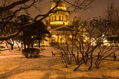 Snowy garden near Saint Isaac's Cathedral in night. Snowy garden near Saint Isaac's Cathedral on St Isaac Square in Saint Petersburg city in night snowfall Royalty Free Stock Image