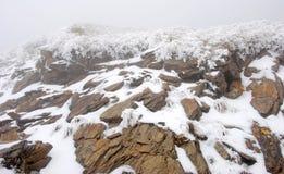 Snowy-Gebirgsszene Stockfoto