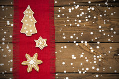 Snowy Ginger Bread Cookies Background Stock Images
