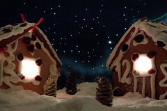 Snowy gingerbread cottage royalty free stock images