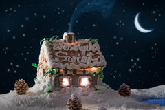 Snowy gingerbread cottage royalty free stock photos