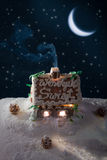 Snowy gingerbread cottage at night Royalty Free Stock Photos