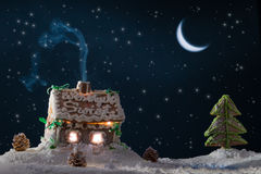 Snowy gingerbread cottage with stars stock photos