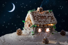 Snowy gingerbread home and moon Royalty Free Stock Photography