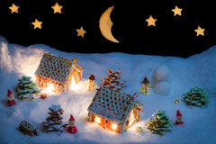 Snowy gingerbread village with stars and moon Stock Photo
