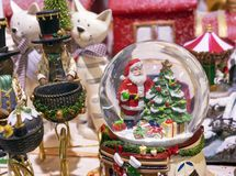 Snowy glass ball with Santa Claus and christmas tree inside stock images