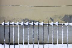 Snowy gratings and wall background stock images