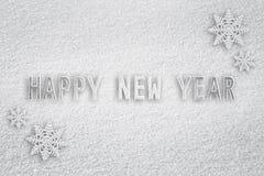 Snowy-guten Rutsch ins Neue Jahr-Schneeflockenhintergrund Stockfotos