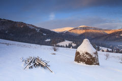 Snowy haystack on the background of the Carpathian Mountains Royalty Free Stock Image