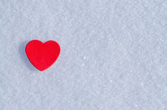 Snowy Hearts. Colorful paper & felt heart Valentines background in the snow Stock Photos