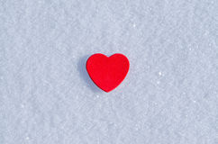 Snowy Hearts. Colorful paper & felt heart Valentines background in the snow Stock Image