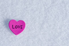 Snowy Hearts. Colorful paper & felt heart Valentines background in the snow Royalty Free Stock Photography