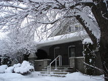 Snowy heritage house scenic. A stately brick heritage house all covered in snow Stock Photography