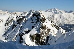 Snowy high summits. View of a stunning high mountains from the ridge in Polish Tatras stock photos