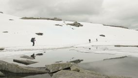 Snowy hiking in the mountains. Norway. Snowy hiking in the mountains - Norway stock video footage