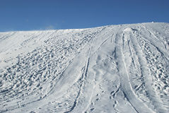 Snowy Hill. Hill covered with white snow and blue clear sky royalty free stock photos