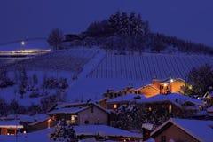 Snowy hill at evening. Alba, Italy. Royalty Free Stock Photos