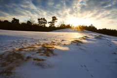 Snowy hill at sunset Royalty Free Stock Photography