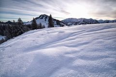 Snowy hills in Alps Stock Photo