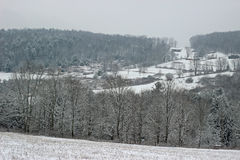 Snowy hilltop. A snow covered rural hilltop with snow covered trees and houses Stock Photography