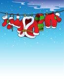 Snowy-Himmel mit Weihnachtskostüm Stockfotos