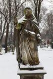 Snowy historic Jesus on winter old Prague Cemetery, Czech Republic Stock Image