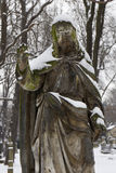 Snowy historic Jesus on winter old Prague Cemetery, Czech Republic Stock Photos