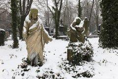Snowy historic Jesus on winter old Prague Cemetery, Czech Republic Royalty Free Stock Image
