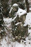 Snowy historic Statue on winter old Prague Cemetery, Czech Republic Stock Photo