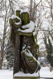 Snowy historic Statue on winter old Prague Cemetery, Czech Republic Stock Image