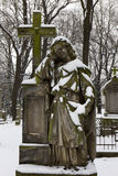 Snowy historic Statue on winter old Prague Cemetery, Czech Republic Royalty Free Stock Images