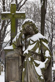 Snowy historic Statue on winter old Prague Cemetery, Czech Republic Royalty Free Stock Photography