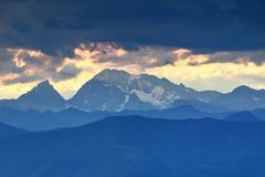Snowy Hochgall / Collalto peak in High Tauern at sunset. Snowy Hochgall / Collalto and Wildgall / Collaspro peaks and blue ridges of Rieserferner / Vedrette di Royalty Free Stock Image