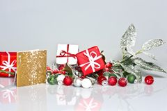 Snowy holly berry with presents. Decoration and greeting card Stock Image