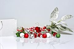 Snowy holly berry with presents Royalty Free Stock Photography