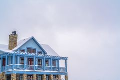 Snowy home with balcony against sky in Daybreak UT. Facade of a beautiful home against bright sky on a snowy winter day. The home has a spacious balcony, front royalty free stock photos