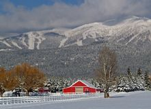 Snowy Horse Ranch. This image of the horse ranch, red barn, snowcovered trees and mountains was taken in western MT Stock Photo