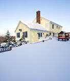 Snowy House. Typical colonial style house in deep snow and ice Royalty Free Stock Photo