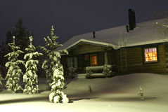 Snowy house in the forest Stock Photo