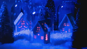 Snowy house at night stock footage