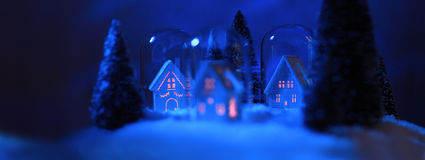 Snowy house at night Stock Photography