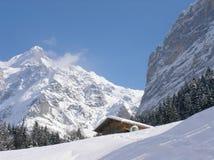 Snowy Hut. Lonely snowy hut in Switzerland Stock Photo