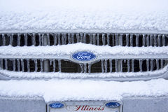 Snowy Icy Ford Ranger Grill. The grill and logo of a 1999 ford Ranger covered with Ice and snow. Also has an Illinois license plate Stock Image