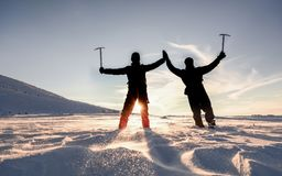 Snowy, icy mountains and successful mountaineers stock image
